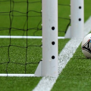 A football which has not quite crossed the goal line.