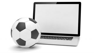 A football and laptop computer which symbolises Betfair football trading on a betting exchange.