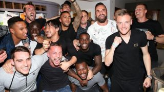Leicester City players celebrate following Tottenham's 2-2 draw with Chelsea.