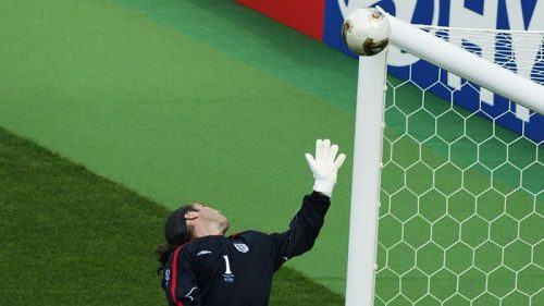 David Seaman is unable to keep Ronaldinho's free-kick out. of the net