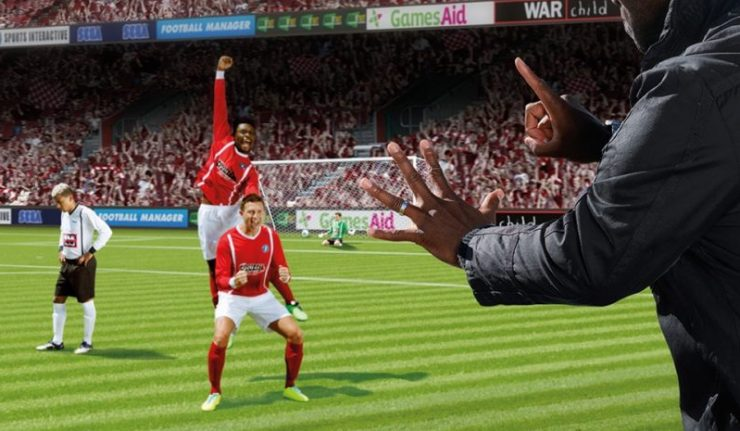 A team celebrate scoring in the Football Manager video game.