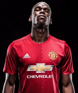 Paul Pogba poses in the 2015/16 Manchester United shirt.