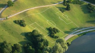 An unusual football pitch painted on a hill in Olympiapark, Munich.