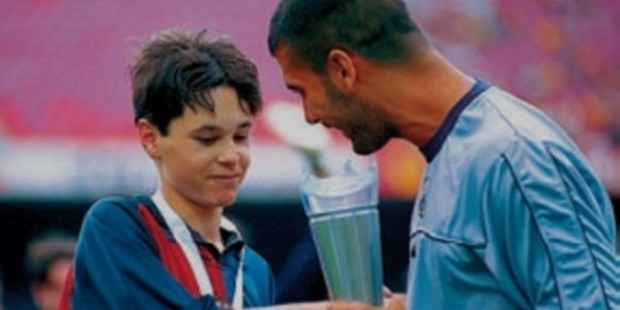 Barcelona captain Pep Guardiola congratulates Andres Iniesta on winning the Nike Premier Trophy in 1999.