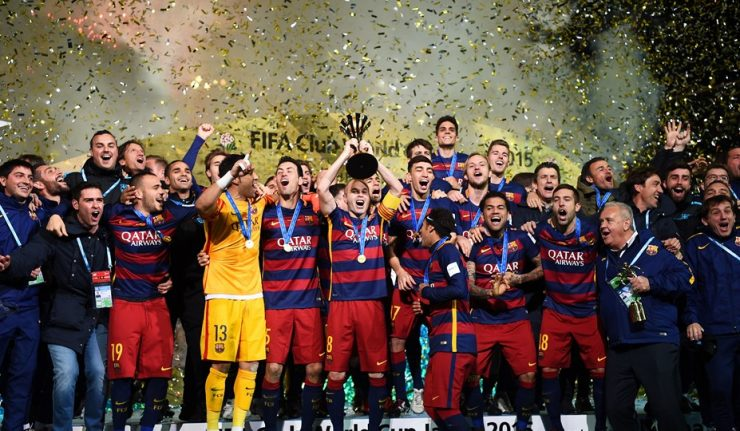 Andres Iniesta lifts the trophy after winning the 2015 Club World Cup.