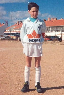 A young Andres Iniesta stands in a Albacete Balompié kit.