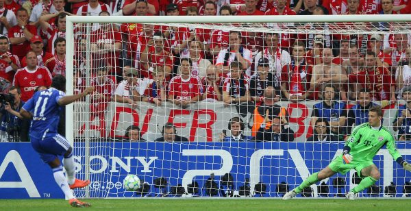 Didier Drogba scores past Bayern Munich's Manuel Neuer to clinch the 2012 Champions League for Chelsea.