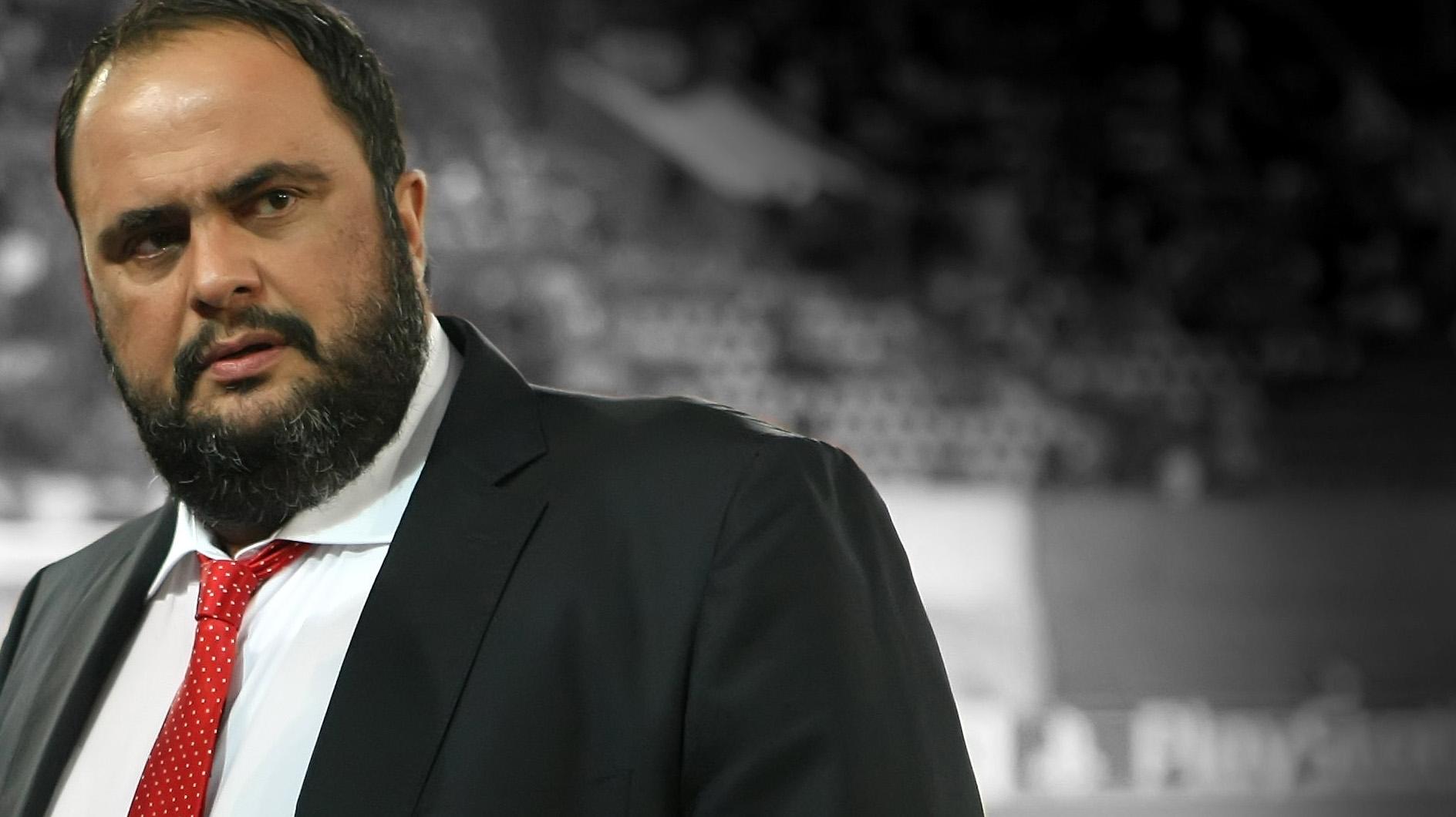 Olympiacos FC president Evangelos Marinakis looks on amid corruption investigation.