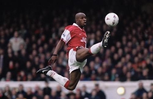 Ian Wright stretches to reach the ball while playing for Arsenal.