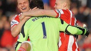 Asmir Begovic celebrates with his Stoke City teammates after scoring against Southampton.