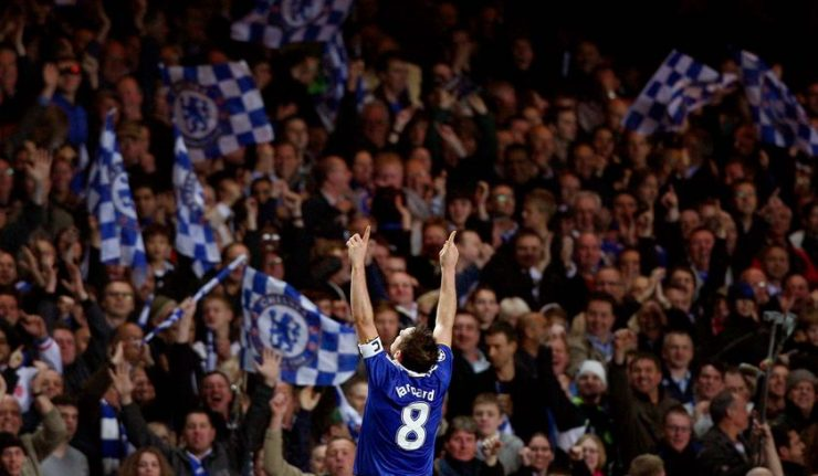 Frank Lampard celebrates in front of the Chelsea crowd.