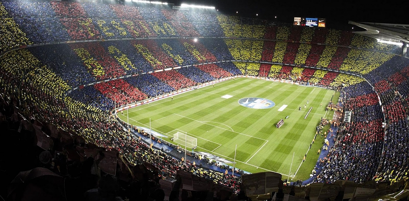 A huge crowd watches on at Barcelona's Nou Camp stadium.