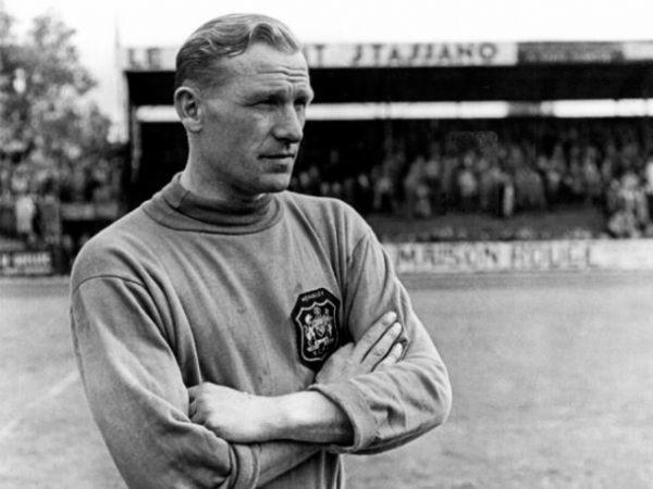 Bert Trautmann stand on the Manchester City pitch.