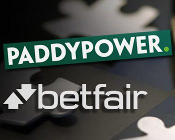 Paddy Power and Betfair logos pictures together following the announcement of a merger deal between the two companies.