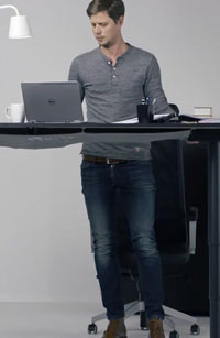 Man using his laptop at a standing desk