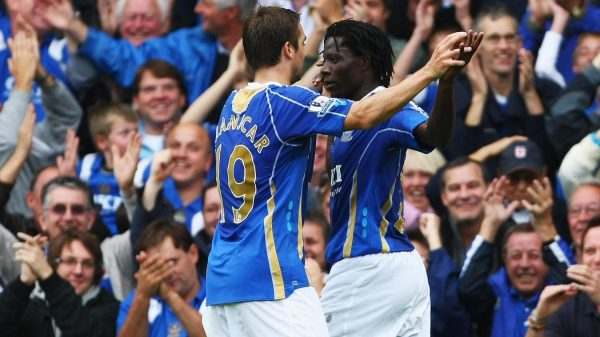 Portsmouth striker Benjani celebrates with team-mate Niko Kranjcar after scoring his third goal in their 7-4 victory over Reading.