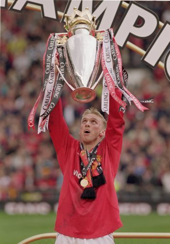 Luke Chadwick lifts the Premier League trophy after winning the competition with Manchester United in 2001.