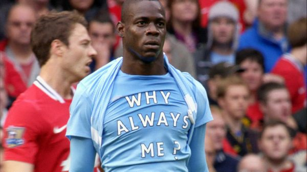 Mario Balotelli reveals a t-shirt baring the phrase 'Why Always Me?' after scoring against Manchester United.