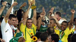 Brazilian icon Ronaldo holds the 2002 World Cup trophy after defeating Germany in the final.
