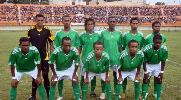 Madagascan football team SO Emyrne line up in their green jerseys ahead of a match.