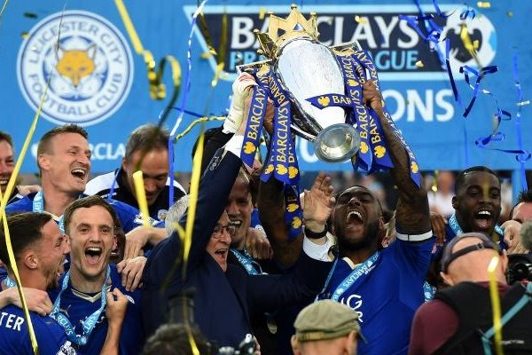 Wes Morgan and Claudio Ranieri lift the Premier League trophy after winning the league in 2016.