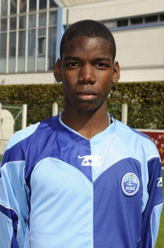 A young Paul Pogba stands in a blue Le Havre AC kit.