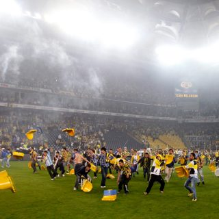 Fenerbahce fans clash with police following a 0-0 draw with Galatasaray.