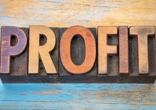 "Wooden letters which spell ""PROFIT"""