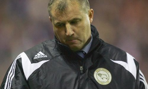 Paul Jewell looks disappointed while managing Derby County.